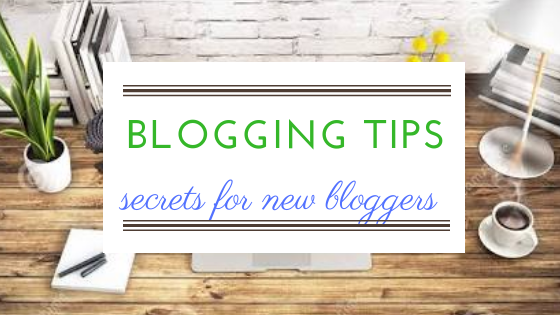 blogging tips written over a laptop on a wooden board